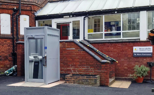 Enclosed Inva Euro platform lift installed outside of the Brownhills Community Centre